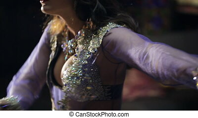 Seductive beautiful brunette shows belly dance. Wonderful...