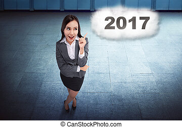Asian business woman thinking about target on the 2017 in...