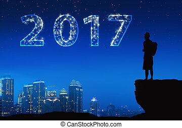 Silhouette asian young man with bright star on a 2017 in the...