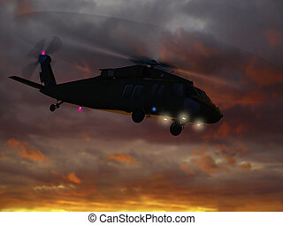 Helicopter UH-60 flying in sunset sky
