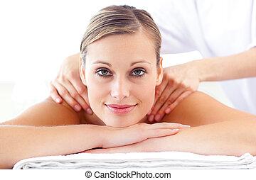 Glowing caucasian woman enjoying a back massage