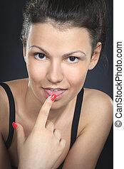 Beautiful sexy stylish woman stick her tongue out