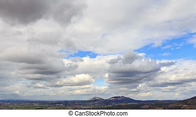 Clouds over the suburbs. Tivoli, Italy. Time Lapse. HDR -...