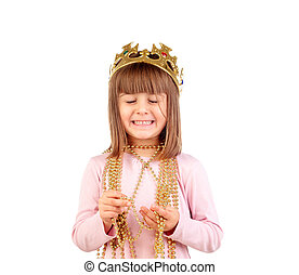 Excited small girl with golden crown and necklace isolated...