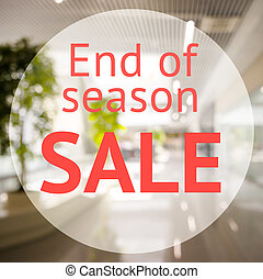 End of season sale sign over blurred store background....