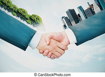 Business concept - Handshake of hands with abstract trees...