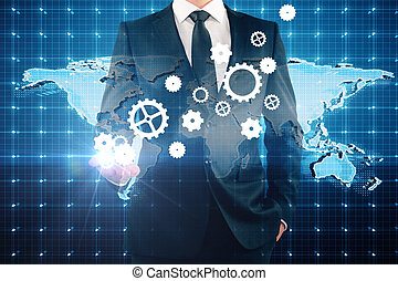 Industry concept - Businessman holding abstract cogwheels on...