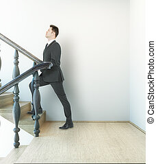 Businessman on stairs - Businessman in interior with...