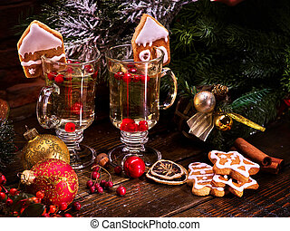 Two glasses of grog, decoration Christmas cookies. - Two...