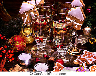 Four glasses of hot wine for family standing on table. -...