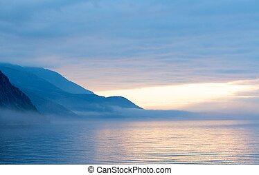 Fog on the Baikal spring sunrise