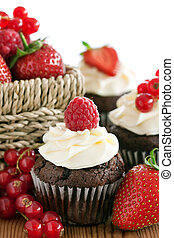 Red berry cupcakes - Chocolate cupcakes decorated with fresh...