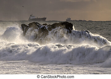 Autumn sea storm at sunset light with rough water over...