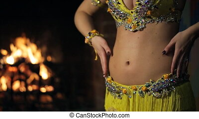 Bellydancer with perfect body dances active inside...