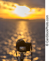 Modern DSLR camera on a tripod - Cropped image with a modern...