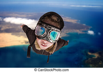 Boy flying, daydreaming he?s a pilot - Boy dressed up in...
