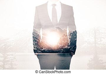 Man on landscape background