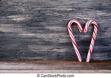 candy canes forming a heart - two typical red an white candy...