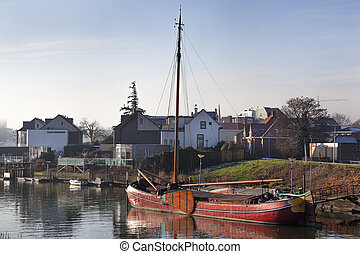 Historic wooden ship moored in dutch village - Historic...