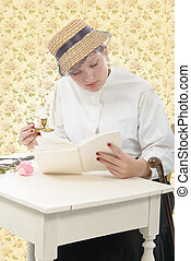 young woman in vintage costume 1900s read a book - young...