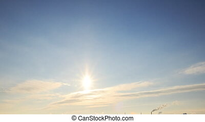 The sun in the clouds. Winter. Russia. Time Lapse. UltraHD...