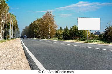 Blank billboard on blue sky with highway - Blank billboard...