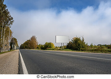 Blank billboard on highway and the background of sky with...