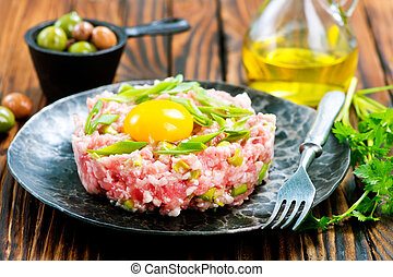 minced meat with spice and raw yolk