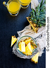 pineapple - fresh juice and pineapple on a table