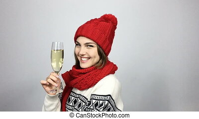Woman celebrating Christmas or New Year with glass of...