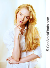 healthy blonde hair - Pretty blonde young woman at home....