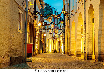 Shopping street with christmas lights in the city center of...