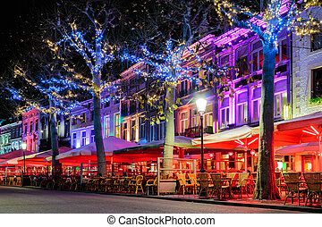 Bars and restaurants with christmas lights on the famous...