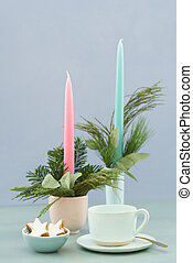 Christmas coffee table in pastels with candles, fir green...