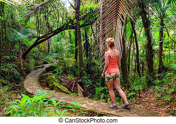 Jungle woman hiking