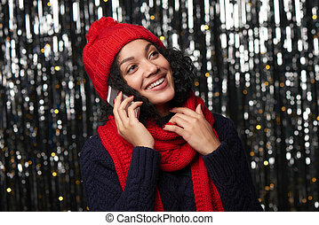 Happy winter woman talking on cell phone - Happy smiling...