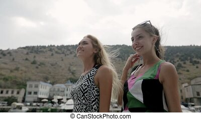 Smiling girls riding on the motor boat in the sea