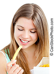 Happy young woman eating fries