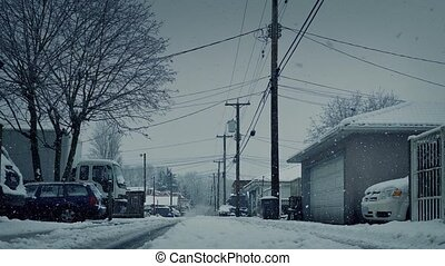 Moving Past Residential Road In Snowfall - Moving over road...
