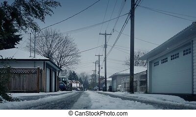 Alley Behind Houses On Snowy Winter Day - Moving over road...