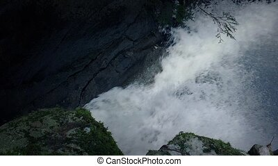 River Gushing Through Canyon - Mountain river gushes into...