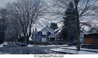 Cars Pass Through Winter Suburbs In Snowfall - Cars drive...