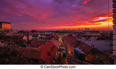 Sunset panorama of Zagreb city from The Strossmayer promenade, Zagreb funicular in the frame