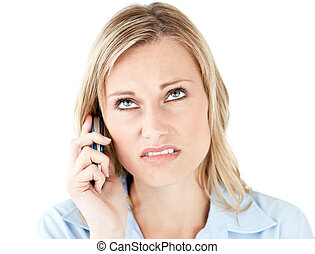 Frustrated businesswoman talking on phone against a white...
