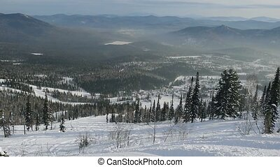 Winter mountains panorama with ski slopes and ski lifts in...