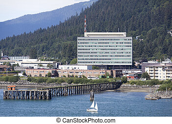 Alaskan Government Building - The small boat passing by the...