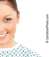 Close-up of a smiling female patient looking at the camera