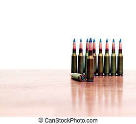 bullets gunshot on the table standing in a row. - bullets...