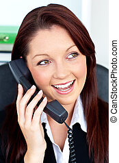 Attractive businesswoman talking on phone sitting