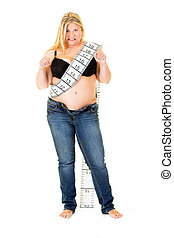 Fat overweight woman wearing a tape measure - Fat overweight...